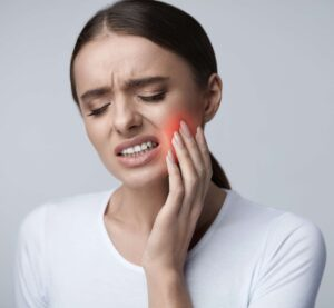 Girl feeling dental pain